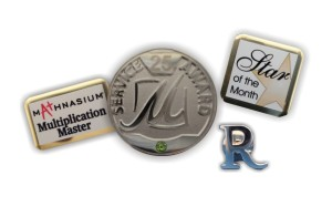 "The round Cloisonné pin was designed exclusively for The Marina Inn by Tag UR It! Inc.! The custom Mathnasium ""Multiplication Master"" pin was also custom designed by our talented Graphics Tag Team!"