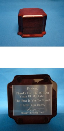 Custom engraved plate on ring box with personal message and engraved handwritten signature.