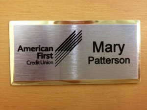 This is a Gold Beveled Name Tag with Silver Face!