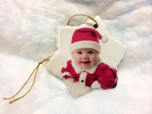 "Our 3"" white porcelain star shaped photo ornament."