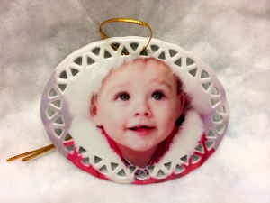 "Our 3.75"" oval shaped white porcelain Christmas ornament"