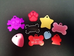 A small sampling of our aluminum pet tags! These tags are offered in many styles, shapes, and colors! Some are even accented with Swarovski elements! These tags can be engraved on one or both sides!