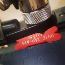 Engraving a dog tag here at Tag UR It! inc.