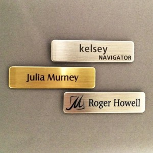 Top is our Silver Nickel name tag with two lines of engraving. Middle is our Brass name badge with a sublimated name. Bottom is another Silver Nickel name tag with sublimated logo and name.