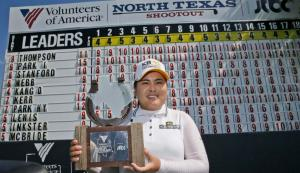 Inbee Park, of South Korea, posses with the champion's trophy after winning the LPGA North Texas Shootout golf tournament, Sunday, May 3, 2015, in Irving, Texas. (AP Photo/LM Otero)